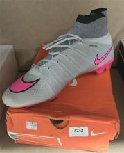 A pair of football boots marked Nike Mercurial Superfly size 44 with box