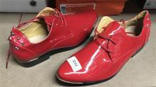 A pair of red patent leather faux croc fashion shoes, size 41