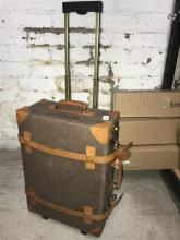 A vintage style carry on suit-case, used, as found