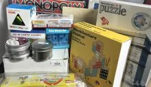 A Monopoly Empire board game plus assorted puzzles