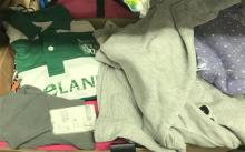 A box of assorted young child clothing
