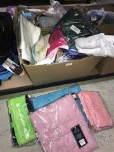 A box of assorted throws, towels & rugs