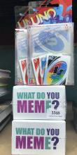 Four assorted car games incl. What do you Meme? & Uno