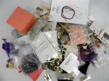 A bag of assorted boxed & bagged costume jewellery