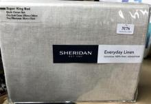 A super king bed quilt cover set marked Sheridan Everyday Linen in flax