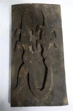A Tribal Plaque in the Form of Two Crocodiles Fighting a Snake,