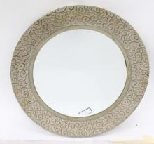 A Circular Silvered Metal Framed Mirror,