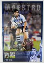 An Autographed Andrew Johns Maestro Poster,