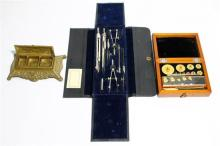 A Timber Cased Set of Gram Weights together with a Brass Ink Stand & a set of Technical Drawing Equipment