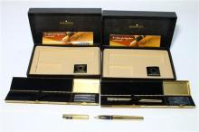 Two Cased Sheaffer Pens in Brass Canisters,