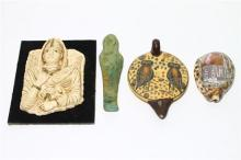 Four Carved Objects including a Green Stone Cast of Tutankhamun,