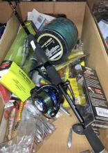 A box of assorted fishing sundries incl. lures, reel, braid etc.