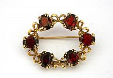 An Oval Shaped Garnet Yellow Gold Brooch