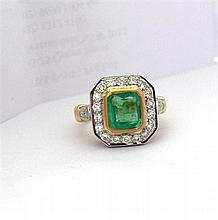 An 18ct Yellow Gold Ring with a 1.52ct Emerald and Twenty Four Diamonds