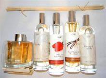 Four various scented room sprays plus reed diffuser