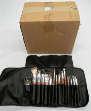 A perspex jewellery organiser together with a make-up brush set
