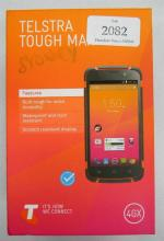 A Telstra Tough Max mobile phone in open box with accessories