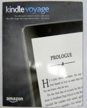 An Amazon Kindle Voyage in sealed box; 4GB