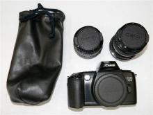 A Canon EOS500 SLR Analogue camera with two Canon 50mm lenses plus