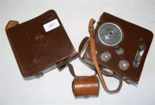 A Eumig vintage movie camera; Serial No. 563669 with original leather case plus 2 x telephoto lenses
