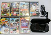 A PSP game console plus seven games, used