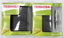 Two Toshiba 1 TG portable drives in open boxes