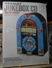 A Crosley table top jukebox CD player in re-sealed box