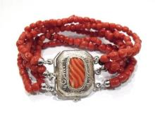 A Six Strand Coral Bead Bracelet with a Silver Coral Clasp,