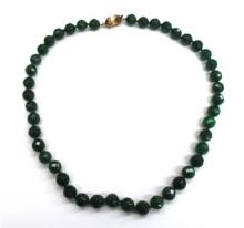 A Strand of Facetted Green Agate Beads with a Gilt Dolphin Clasp,