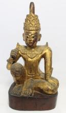 A Gilt Wood Spirit Figure, Elaborately Carved in the Position of ''Royal Ease,'' Burma, 19th/20th Century,