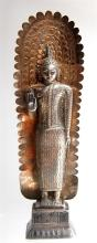 A Silver Buddha Standing with a Form Fitting off-the-shoulder Robe, Sri Lanka, 20th Century,