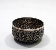 A Repoussé Silver Bowl, a Plain Rim framing the Floral Body an Impressed Peacock to the Base