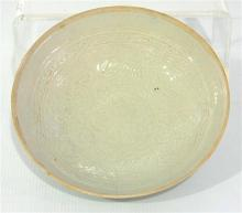 A Chinese Circular Bowl, Incised on the interior with floral scrolling, decoration in the style of Song Dynasty,