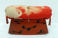 A Geisha Silk Covered Pillow on Raised Red Nagoro Lacquer Stand, Taisho Period