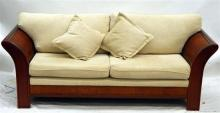 A Three Seater Sofa in Cream Upholstery,