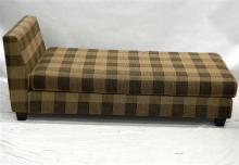 A Modern Open Back Lounge in a Brown Check Upholstered Pattern,