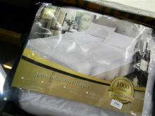 A Royal Comfort Deluxe Microfibre topper, queen size