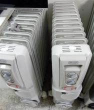 Two DeLonghi oil column heaters with fans, model DL2401TF