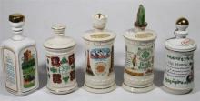 A Collection of Five Old Fitzgerald Irish Whisky Ceramic Decanters,