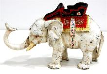 A Vintage Cast Iron Articulated Elephant Money Box, early 20th Century,