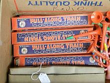A box of miniature pull along trains made by Wee Folks, Australia (approx 20) with plastic trumpets