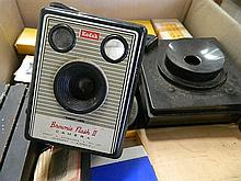 A Kodak Brownie Flash 2 camera together with a box of accessories