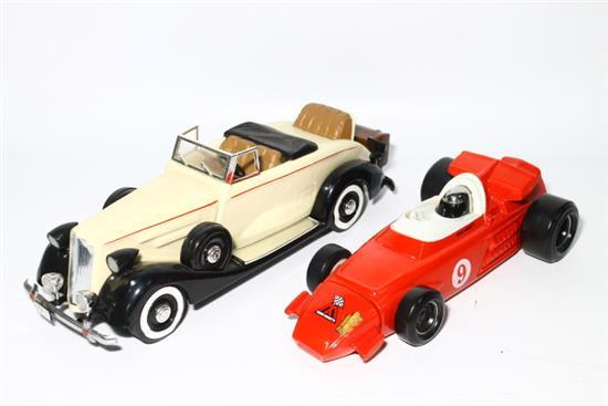 A Jim Beam 1937 Roadster Decanter together with Mario Andretti OMB19