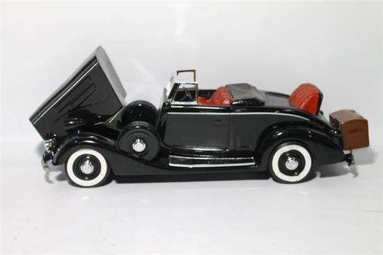 An Aesthetic Specialties Model 1937 Black Cadillac Decanter,