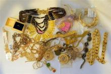 A bag of mostly gold coloured costume jewellery