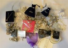 A bag of mostly silver coloured costume jewellery etc.