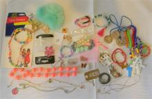 A bag of kids costume jewellery