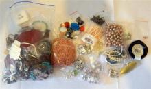 A bag of misc. costume jewellery plus a bag of jewellery making components