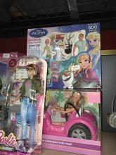 Three young girl toys incl. game developer barbie, beach car & Frozen story book