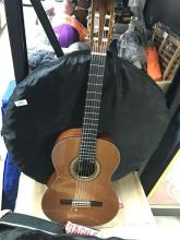 A Miguel Estebam guitar with case plus another, all faults